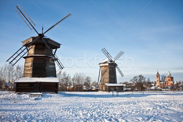 two windmills and church Stock photo © kyolshin