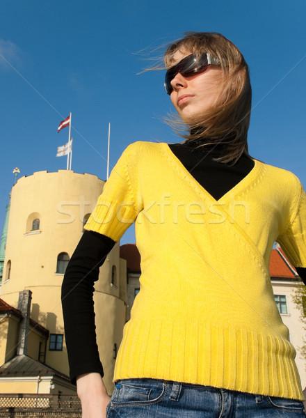young girl against Latvia president palace Stock photo © kyolshin