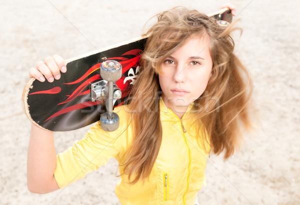 Portrait of pretty girl with skateboard outdoor. Stock photo © kyolshin