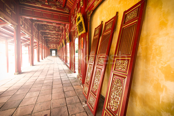 Red wooden hall of Hue citadel in Vietnam, Asia. Stock photo © kyolshin