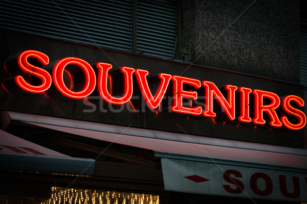 Red neon sign on souvenirs shop in Vienna, Austria Stock photo © kyolshin