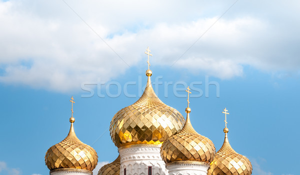 Golden domes of russian church against blue sky. Stock photo © kyolshin