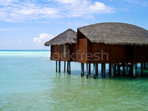 Bungaló fotó víz trópusi sziget Maldív-szigetek természet Stock fotó © kyolshin