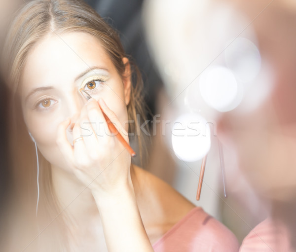 Young pretty woman getting make-up with brush. Stock photo © kyolshin