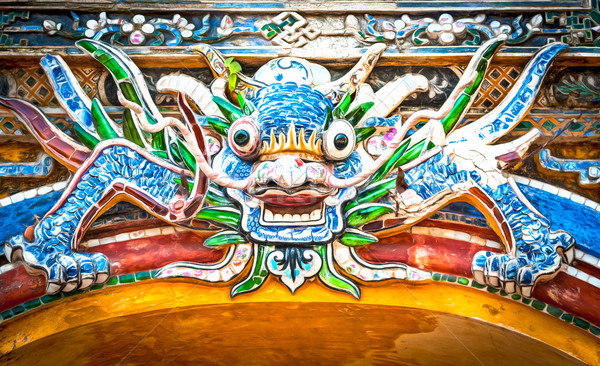 Dragon over gate to Hue citadel. Vietnam, Asia. Stock photo © kyolshin
