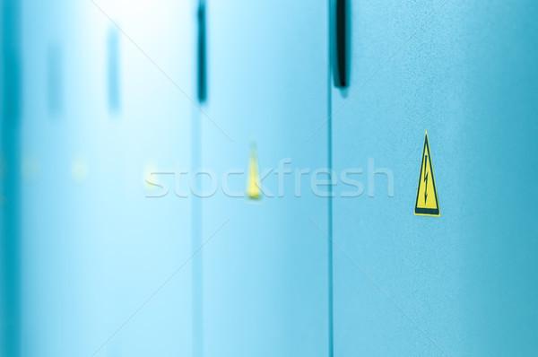 Amarelo alta tensão assinar azul portas fechado Foto stock © kyolshin