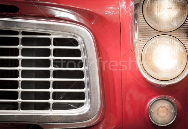Close Up of Grille and Headlights of Red Vehicle Stock photo © kyolshin