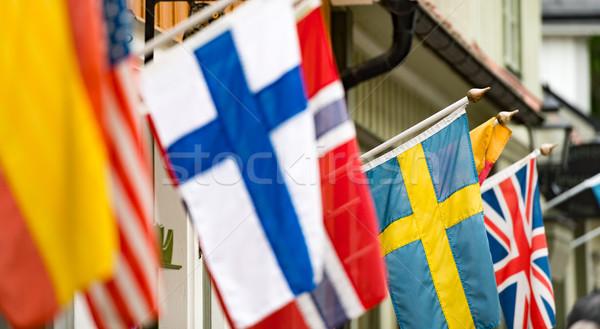 Zászlók fal épület Svédország sok óváros Stock fotó © kyolshin