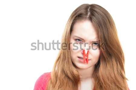 Dziewczyna clothespin nosa nieszczęśliwy młoda dziewczyna uczucie Zdjęcia stock © kyolshin