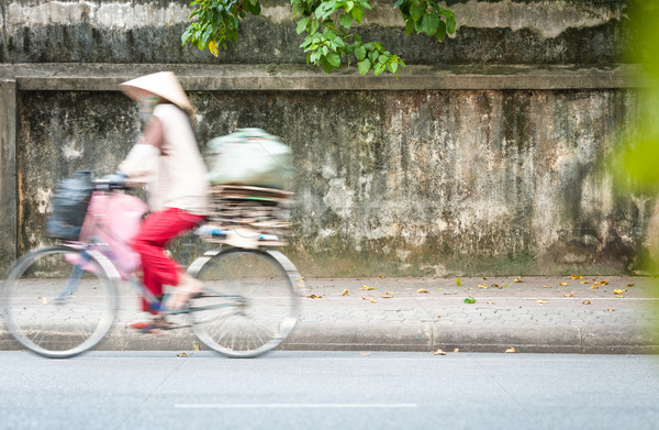 Person riding bicycle on road in Vietnam, Asia. Stock photo © kyolshin