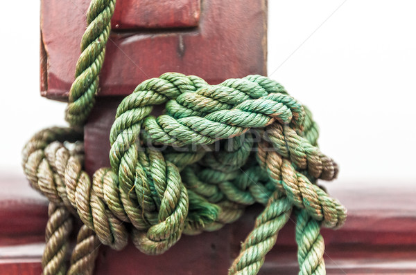 Close-up of rope with tied sea knot on ship deck. Stock photo © kyolshin