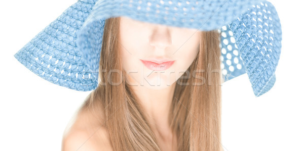 Young woman with half hidden face under blue hat. Stock photo © kyolshin