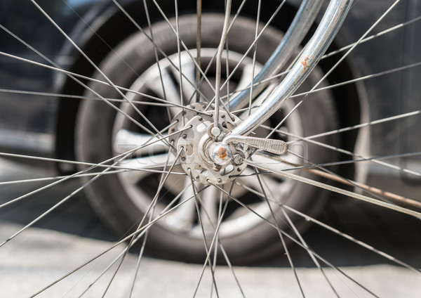 Bicycle versus car. Wheels against each other. Stock photo © kyolshin