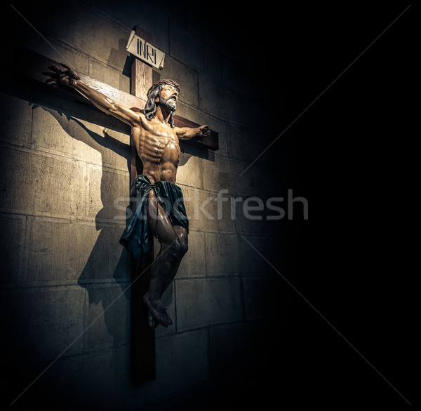 Crucifix in church on the stone wall. Stock photo © kyolshin