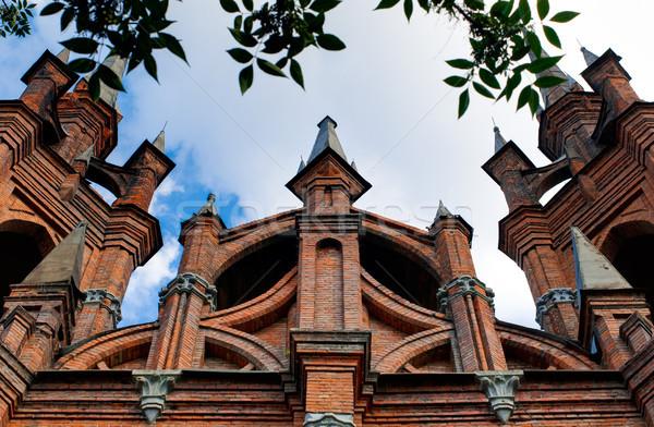Catholique église vieux ciel bleu nuages bâtiment Photo stock © kyolshin