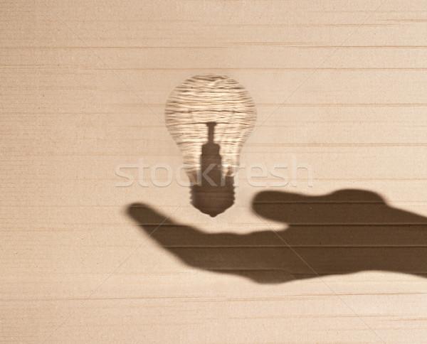 Stockfoto: Gloeilamp · menselijke · hand · schaduw · karton · hand