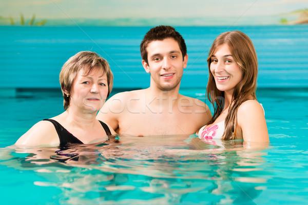 Wellness nő pár úszómedence érett nő fiatal pér Stock fotó © Kzenon