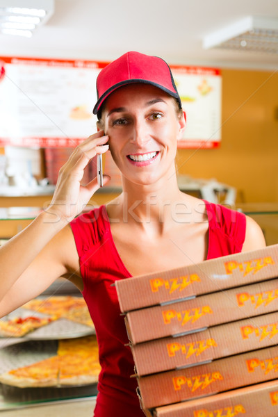 Delivery service - woman holding pizza boxes Stock photo © Kzenon