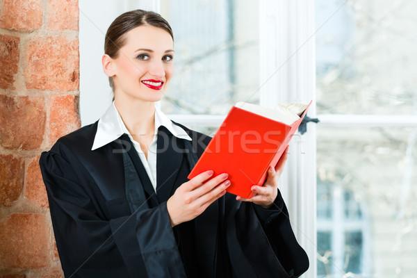 Lawyer in office reading law book Stock photo © Kzenon