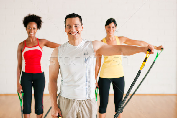 Gimnasia formación gimnasio grupo tres personas colorido Foto stock © Kzenon
