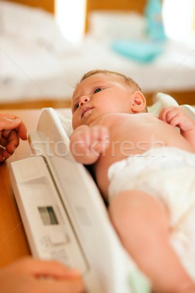 Baby on weight scale Stock photo © Kzenon