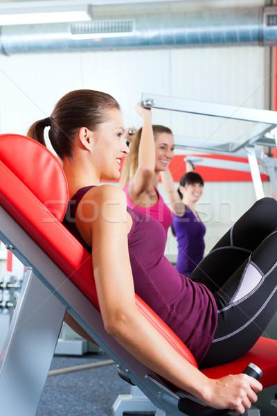 gym people doing strength or sports training  Stock photo © Kzenon