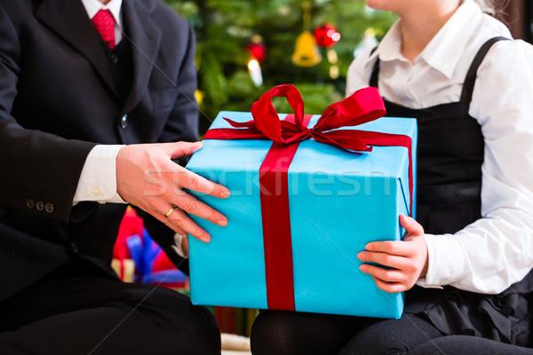 Family giving presents on Christmas day Stock photo © Kzenon
