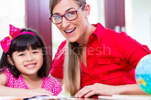 Professor linguagem chinês criança lição de casa Foto stock © Kzenon