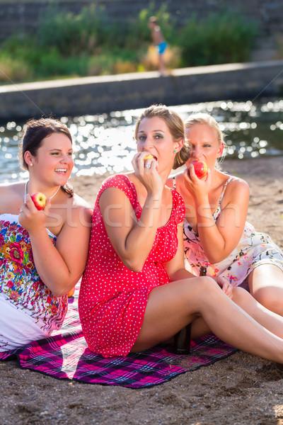 Friends drinking beer at river beach Stock photo © Kzenon