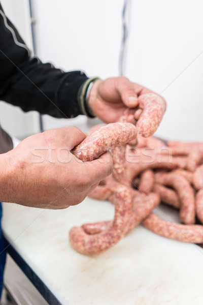 Butcher making sausages in meat factory Stock photo © Kzenon