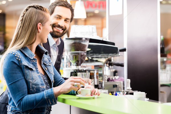 Woman enjoying espresso in cafe Stock photo © Kzenon