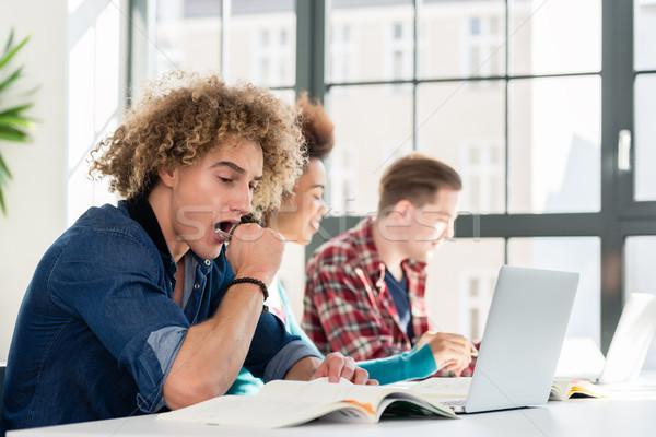 Engraçado estudante livro sessão para baixo Foto stock © Kzenon