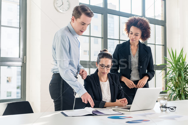 Three young colleagues talking during break in the meeting room Stock photo © Kzenon