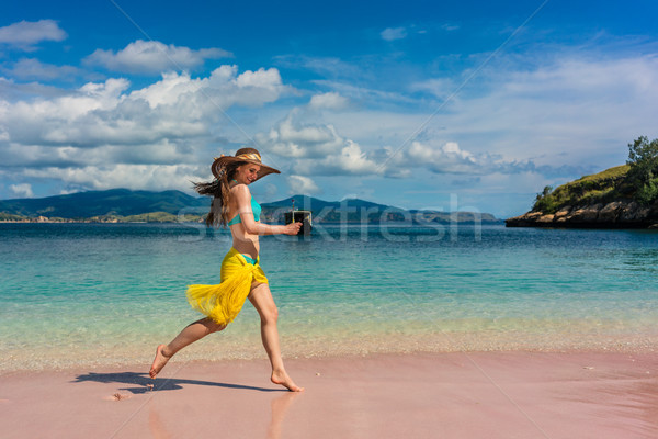 Fashionable young woman enjoying happiness and freedom on tropical beach Stock photo © Kzenon