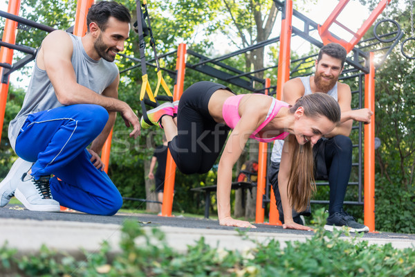Fit woman doing leg extension with suspension trainer Stock photo © Kzenon