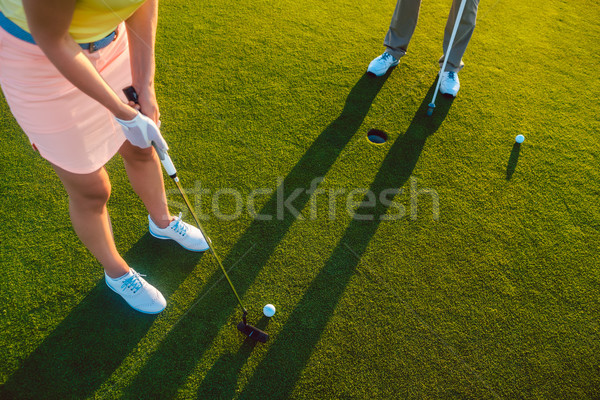 Woman player ready to hit the ball into the hole at the end of a game Stock photo © Kzenon
