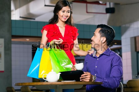 Cheerful woman showing to her best friend her purchase Stock photo © Kzenon
