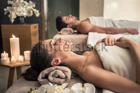 Young couple relaxing under the stimulating effects of a hot sto Stock photo © Kzenon