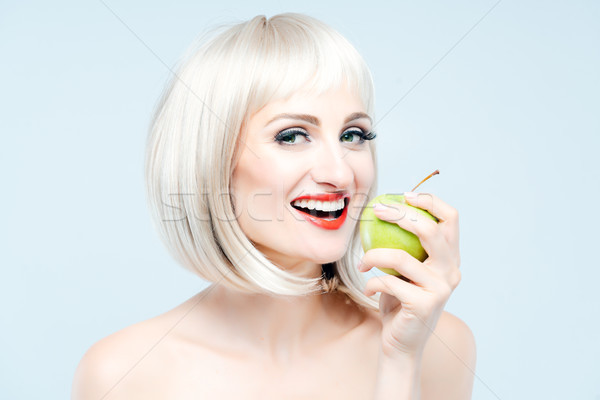 Beautiful woman eating green apple for weight loss Stock photo © Kzenon