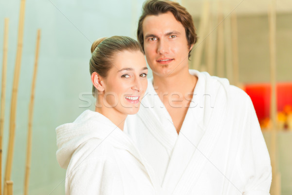 Young couple in bathrobe in Spa Stock photo © Kzenon