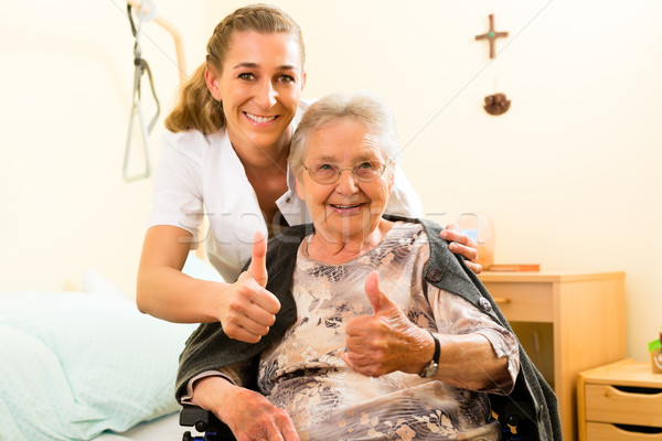 Stock photo: Young nurse and female senior in nursing home
