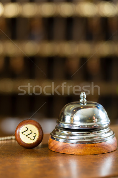 Reception - Hotel bell and key lying on the desk Stock photo © Kzenon
