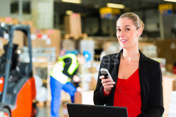 dispatcher using phone at warehouse of forwarding Stock photo © Kzenon