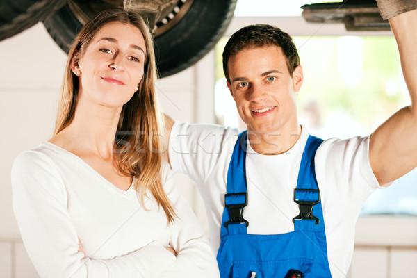 Mechanic repairing car of woman Stock photo © Kzenon