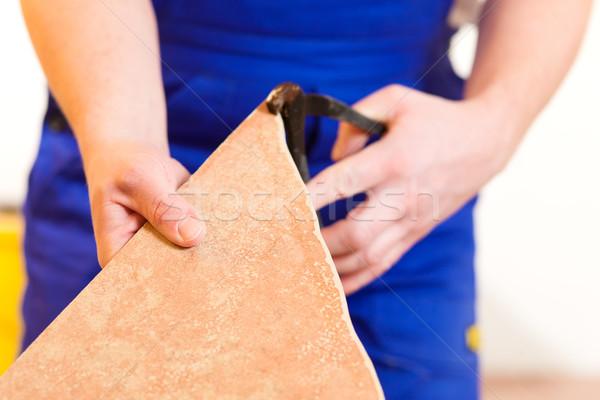 Zsindelyezés csempék padló építőmunkás otthon ház Stock fotó © Kzenon