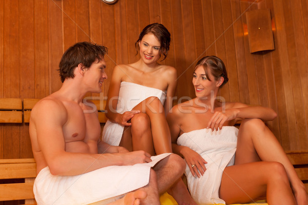Stock photo: Three people or friends in sauna