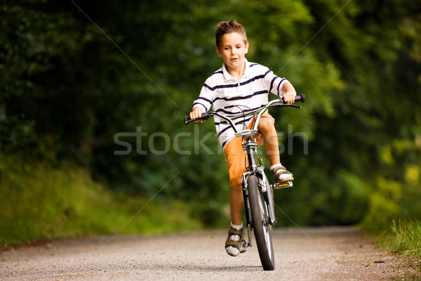 Boy riding bicycle Stock photo © Kzenon