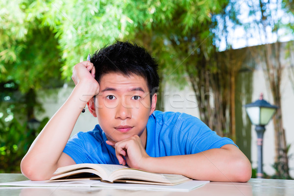 Young Chinese Boy with homework for school Stock photo © Kzenon