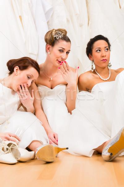 Brides drinking too much champagne in wedding shop Stock photo © Kzenon