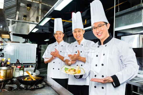 Asian Chefs in hotel restaurant kitchen  Stock photo © Kzenon
